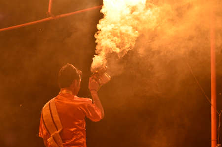 Man Performing with Smoke at Aarti Ceremony in the Ganges River in Varanasi, India