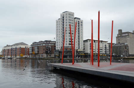 Red Metal Structures in The Grand Canal Square at The River Liffey in Dublin, Ireland