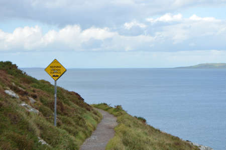 Uneven Surface Sign on the Rocky Mountain Walking Track by the Sea Coast in Ben of Howth, Ireland Stok Fotoğraf