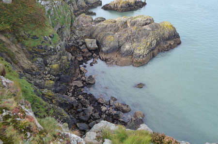 Down View to the Sea of Rocky Mountain Cliff  from Ben of Howth, Ireland Stok Fotoğraf