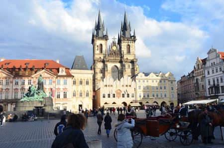 Tourists on The Old Town Market Square and Church of Our Lady Before Týn in Prague, Czech Republic