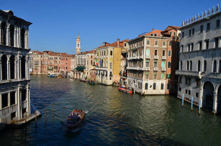 Bridge View of Tourists on a Boat at the Canal in Venice, Italy