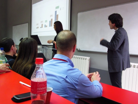 Young business people giving presentation in modern conference room Standard-Bild