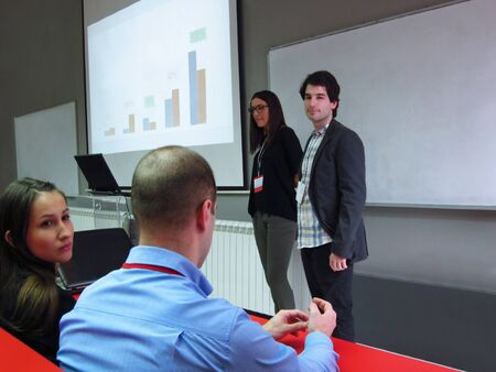 Young business people giving presentation in modern conference room Banco de Imagens