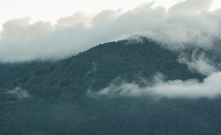 duskiness: Beautifol clouds above mountain at morning sunrise