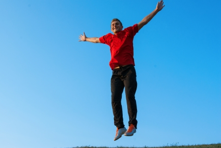 Young man workout at beautiful sunny day Stock Photo