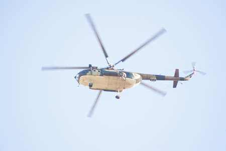 helicopter pilot: military helicopter flying at the beautiful sunny day blue sky