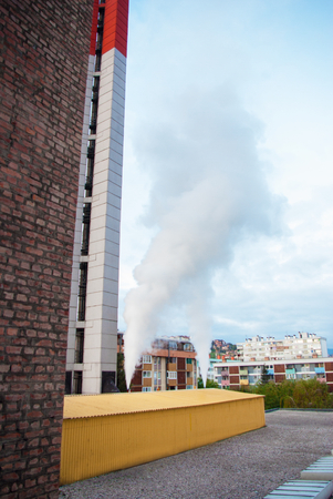 tec: big heating plant building and  chimney at beatiful sunny morning