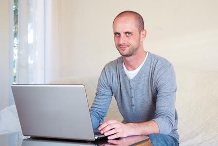handsom: Handsom young business entrepreneur working at home office laptop