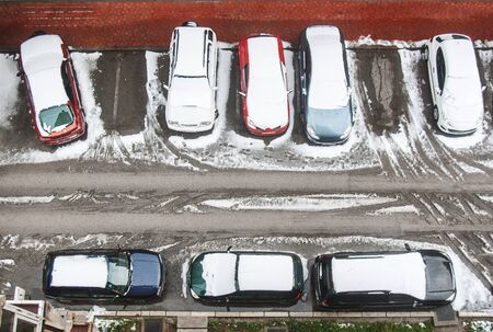 seson: Cars covered with snow on the parking lot from the top view at winter seson Stock Photo