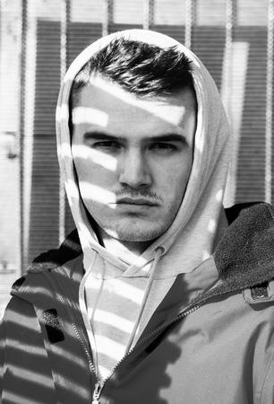 film noir: film noir style lights and shadow man face