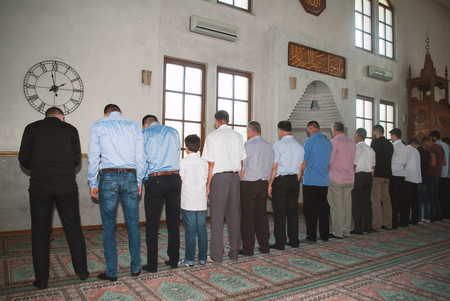 madina: Group of muslims standing at prayer in beautiful decorated mosque