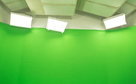 modern tv studio green screen chroma key background with camera