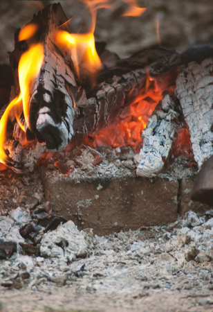Burning fire in fireplace outdoor. Preparing launch outdoor at fireplace
