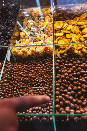 Superfood candies aranged on the shelf in candy shop market Stock Photo