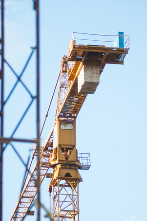 Building of modern apartment in the city center with crane and construction machines