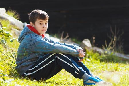 Beautiful kid enjoying outdoor sun at beautiful natural environment