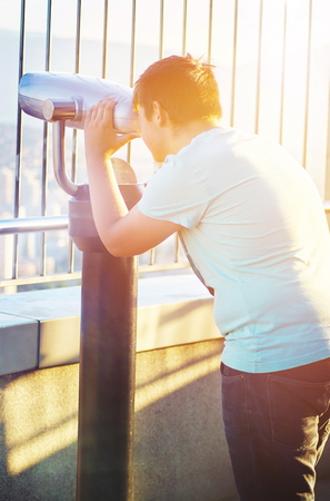 Cute teen boy have good time outdoors in urban environment at sunny day