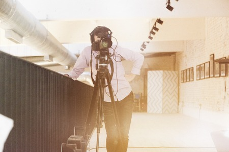 Cameramen professional recording with modern equipment at big coworking office space.