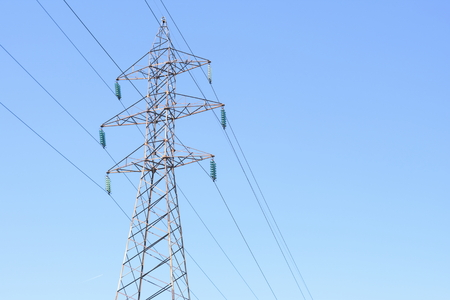 High voltage electric transmission tower energy pylon. Fades perspective Stock Photo