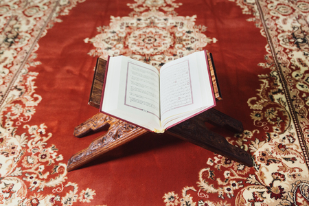 Islamic holy book quran in mosque opened for reading and prayer