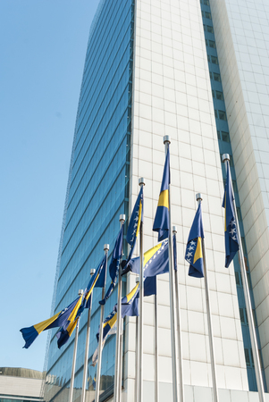 Flags of Bosnia and Herzegovina on a modern building