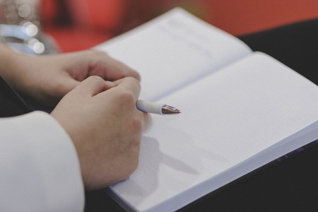 Writing paper notes at buseinss presentation.Businessman having presentation on meeting. 版權商用圖片