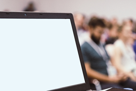 Laptop on Business presentation desk with blured people in the background bokeh. Standard-Bild