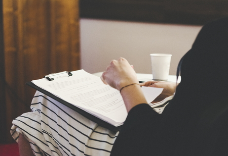 Business woman taking notes at the meeting. Business and success concept. Standard-Bild - 121351152