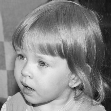 curly headed: portrait of blond small girl