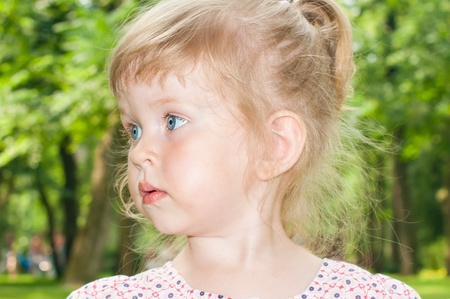 curly headed: Portrait of the small nice girl  Stock Photo