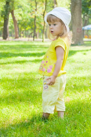 curly headed: The nice little girl in park Stock Photo