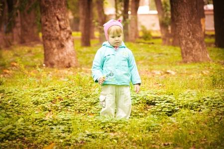 The small child walks in autumn park (28)(22).jpg photo
