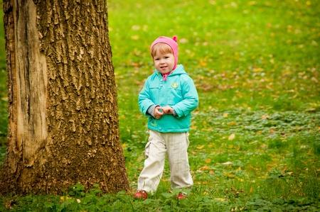The small child walks in autumn park photo