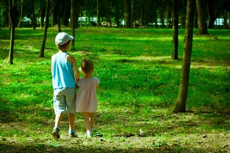 The boy and the girl walk in park  photo