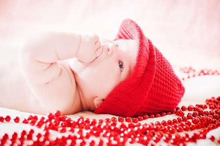 cute baby in red winter hat Stock Photo