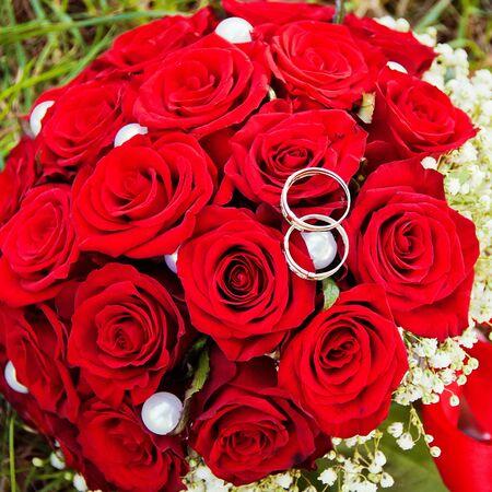 Wedding rings  on flowers photo