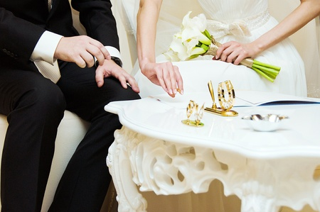 Bride and groom signing wedding documents  Stock Photo