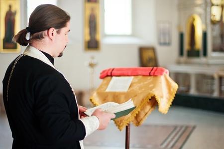 A  priest  in the church photo