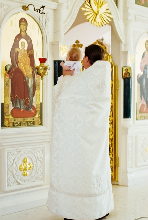christening ceremony in church photo