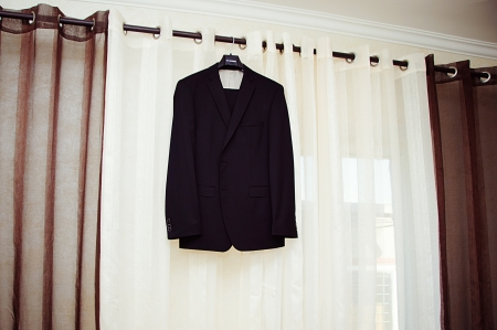 Suit jacket hanging on a hanger