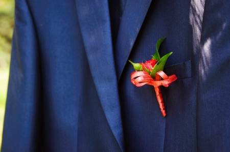 Wedding boutonniere on suit jacket of groom photo