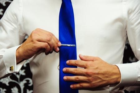 businessman correcting a tie photo