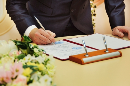groom sign wedding contract Stock Photo