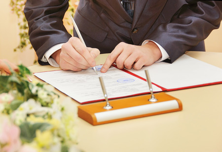 groom sign wedding contract photo