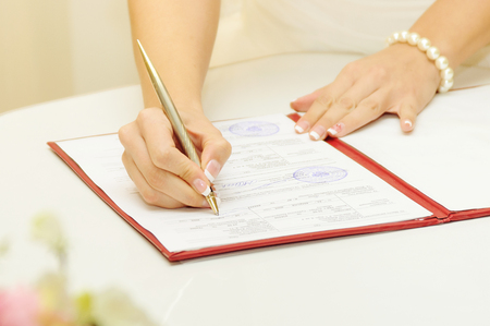 marriage certificate: Beautiful bride sign up marriage certificate