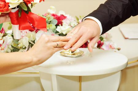 bride groom wears the ring wedding photo