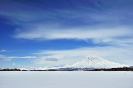 Winter landscape with frosty volcano on snow background