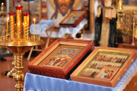 Holy Bible and Orthodox cross prepared for christening ceremony in russian church