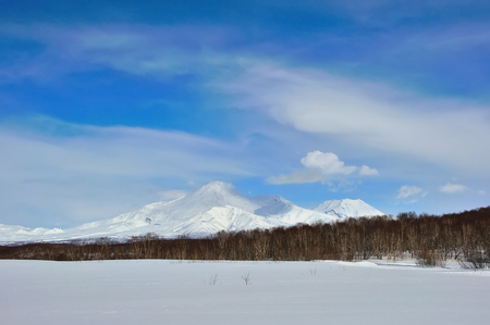 Volcano with snow in winter day in Russia on Kamchatka Stock Photo
